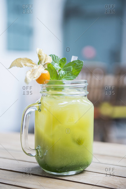 Close-up of green mocktail served in jar glass
