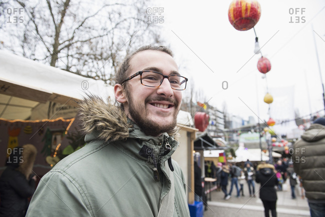 Portrait of young man at Christmas market