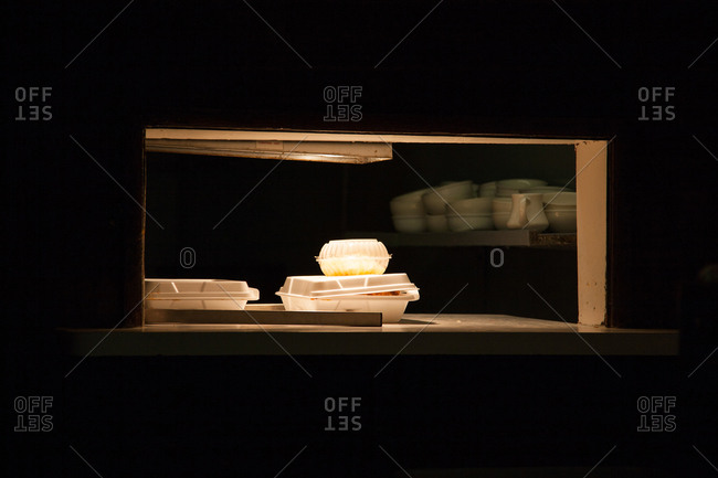 Takeout boxed food in restaurant pickup window