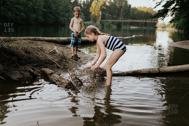 Young children building a dam in river