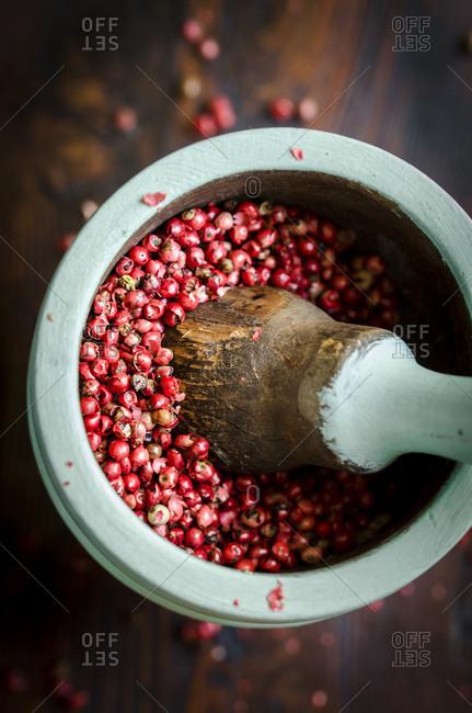 Red peppercorns in a mortar
