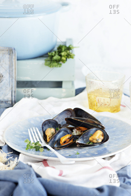 Mussels on a blue plate