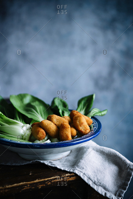Chinese cabbage, Pak Choi on a blue background with potato Croquettes