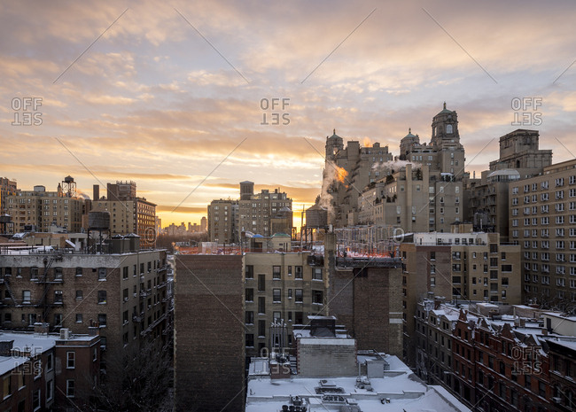 Snowy rooftops at sunset on the upper west side in New York City