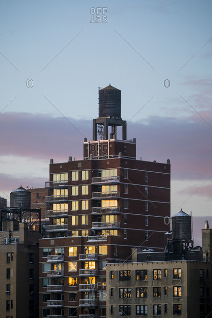 Water towers on top of a building at sunset in New York City