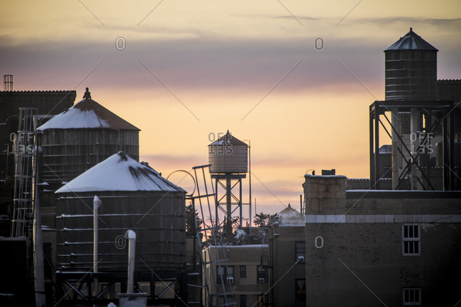 Water towers on top of buildings at sunset in New York City