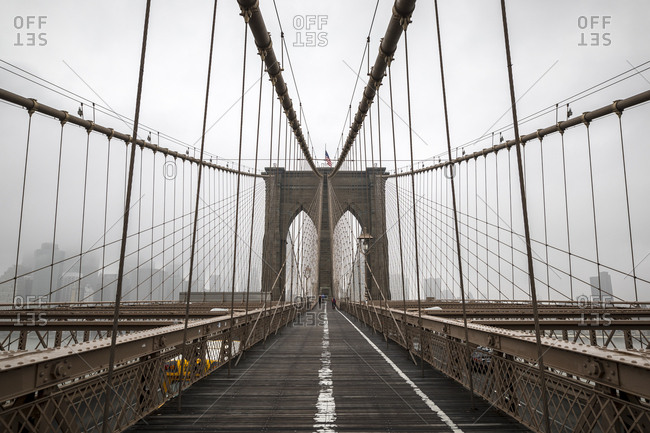 Brooklyn Bridge on a cold and foggy morning in New York City