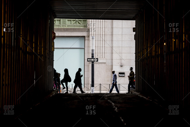 New York City, New York, USA - April 27, 2017: Commuters walking to work in Wall Street in New York City