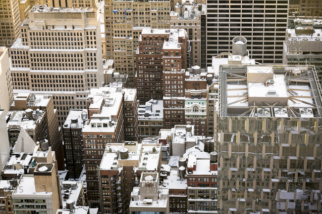 Snow covered rooftops in midtown New York City as seen from above during winter