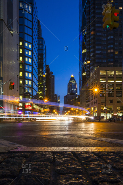 New York City, New York, USA - September 5, 2015: Cars and traffic lights on a busy New York City street at night