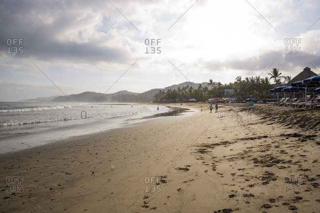 Sayulita, Mexico - April 28, 2016: A long stretch of beach in Sayulita, Mexico