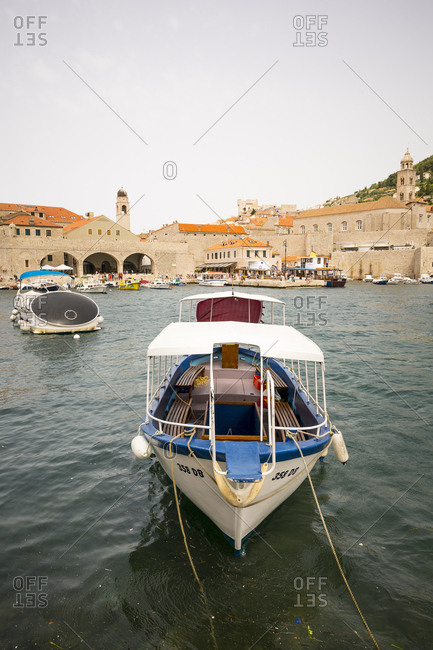 Dubrovnik, Dalmatian, Croatia - June 17, 2016: Boats in the harbor of old town Dubrovnik in Croatia