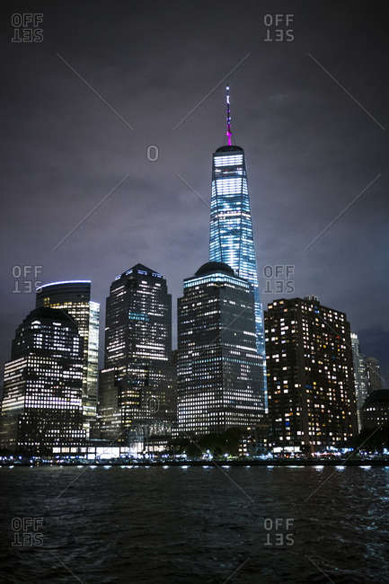 New York City, New York, USA - October 30, 2016: New York City at night as seen from a ferry in the river