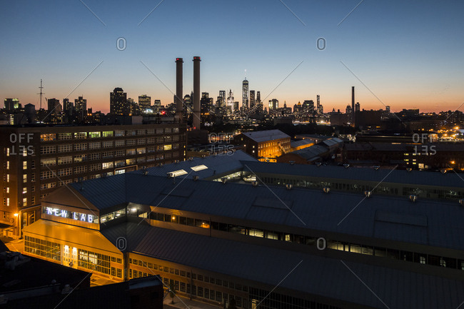 New York City, New York, USA - June 9, 2016: A night view of Manhattan from a rooftop in Brooklyn