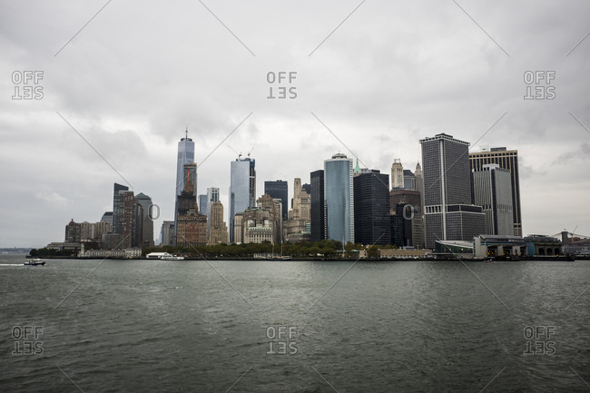 View of tall buildings and skyscrapers of Manhattan from a ferry boat