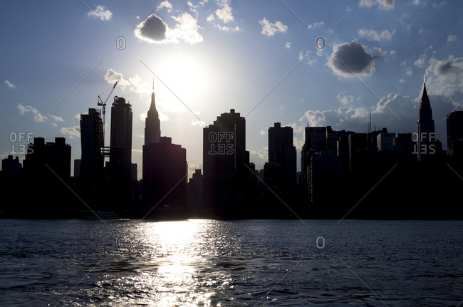 Looking out across the East River at silhouette of Manhattan from Long Island City, in Queens