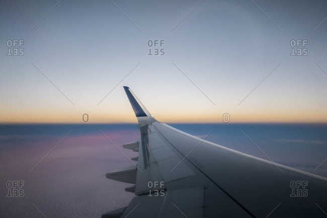 Airplane wing in a sunset