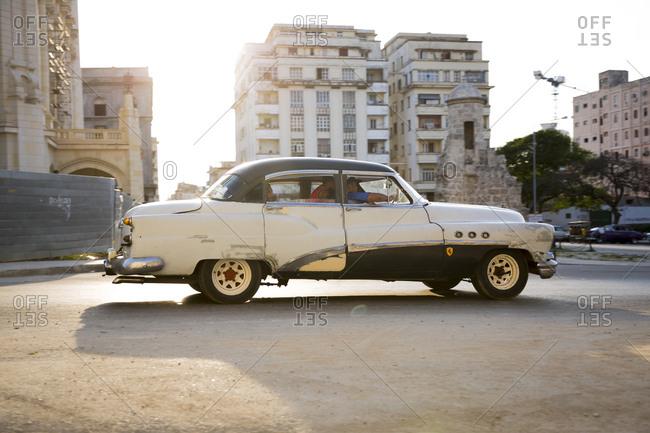 Havana, Cuba - April 30, 2016: Antique car driving along malecon