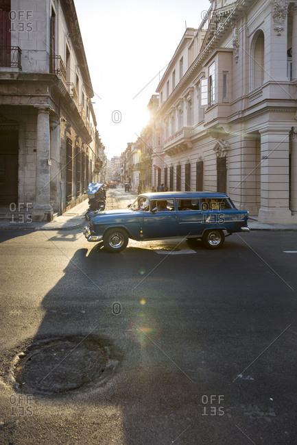 Havana, Cuba - April 30, 2016: Antique car driving in sunny street