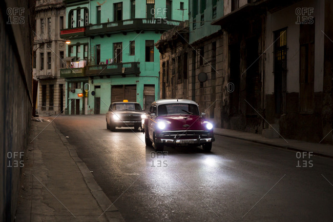 Havana, Cuba - April 30, 2016: Cars driving in a street