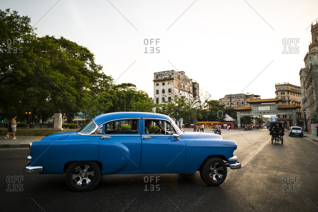 Havana, Cuba - May 1, 2016: Car driving through city streets
