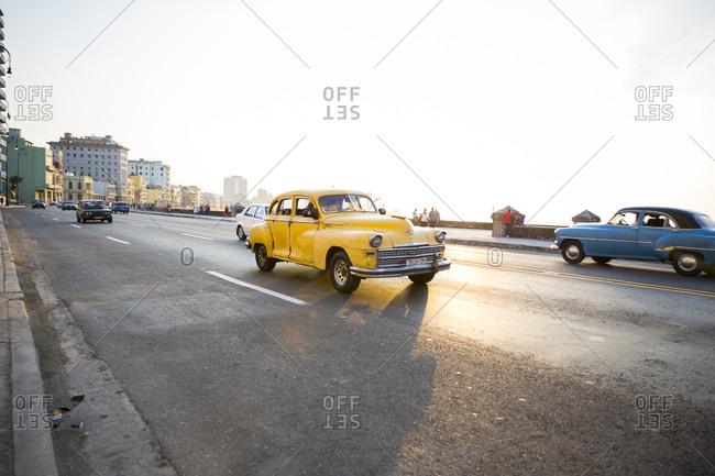 Havana, Cuba - May 2, 2016: Vintage cars driving in oceanfront street