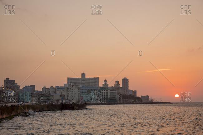 Sun setting over ocean, Havana, Cuba
