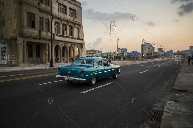 Havana, Cuba - May 2, 2016: Vintage car driving at dusk