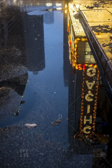 Chicago, Illinois - December 11, 2016: Chicago Theater sign in puddle