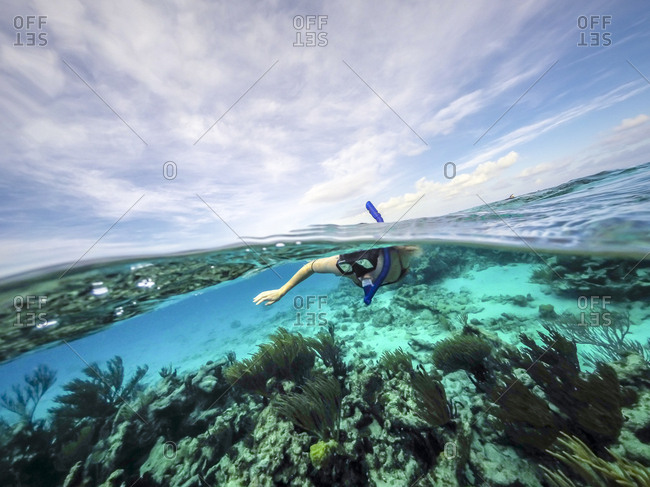 A woman snorkeling in Grand Cayman