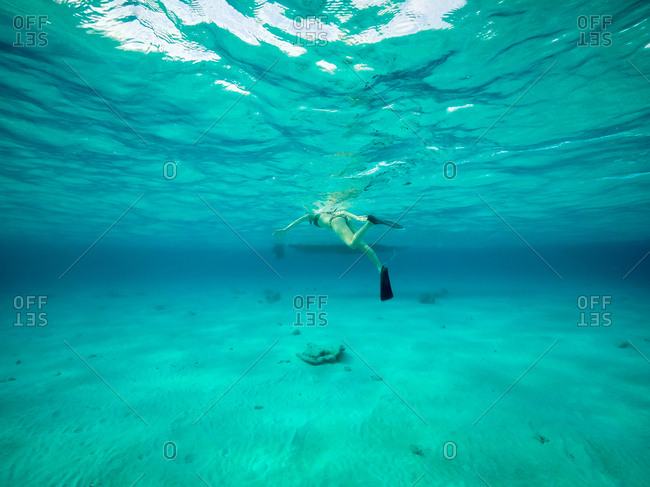 Woman snorkeling in Grand Cayman