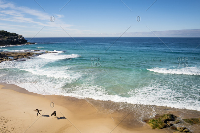 Sydney, Australia - May 25, 2017: Two surfers one Tamarama beach