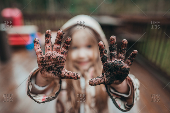 Portrait of girl showing dirty hands