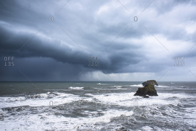 Scenic view of stormy clouds over sea