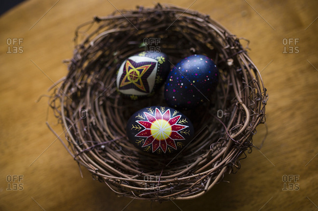 High angle view of Easter eggs in nest on wooden table