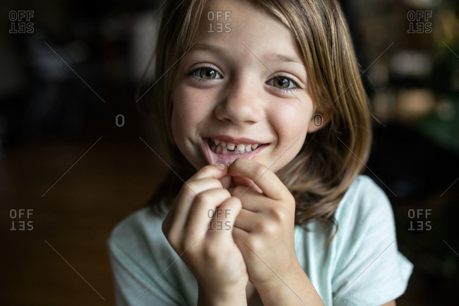 Fantastic Portrait Of Happy Girl Showing Tooth Gap At Home Stock Photo Interior Design Ideas Clesiryabchikinfo