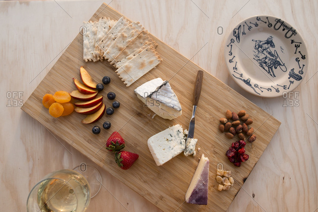 Overhead view of food on cheese board outside sports utility vehicle