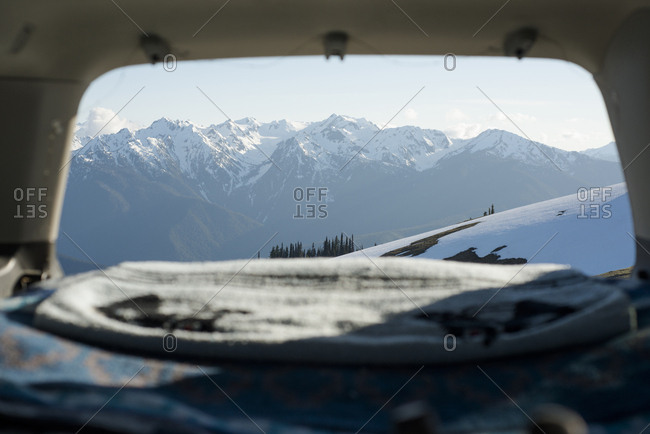 Scenic view of snowcapped mountains seen from sports utility vehicle