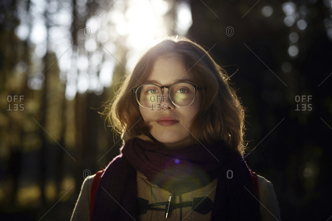 Portrait of woman in eyeglasses at forest