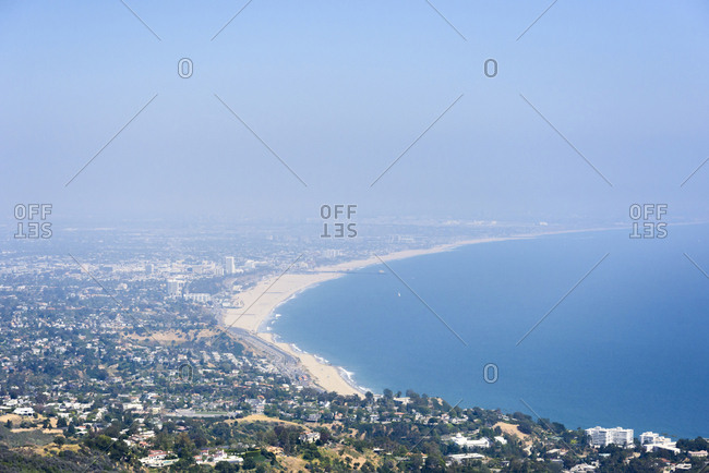 Aerial view of cityscape and sea against sky
