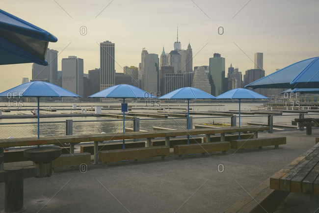 Parasols on promenade against city skyline