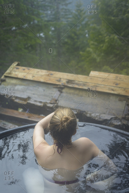 High angle view of woman bathing in hot spring