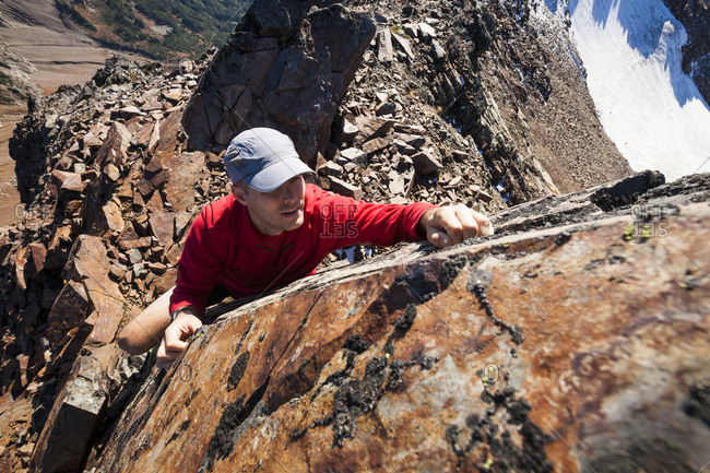 High angle view of hiker climbing rocky mountains