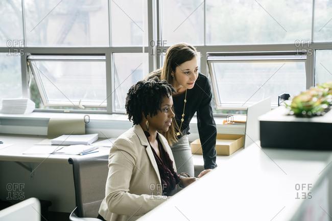 Businesswomen using desktop computer in office
