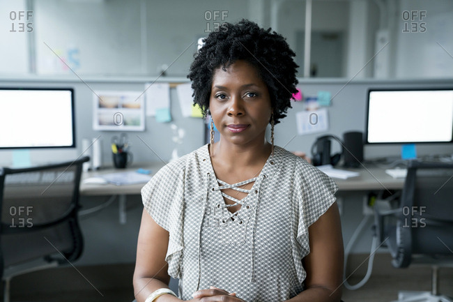 Portrait of confident businesswoman sitting in office