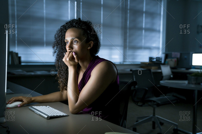 Businesswoman using desktop computer at desk in office