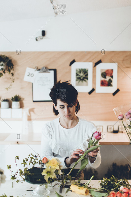Florist working at table in flower shop