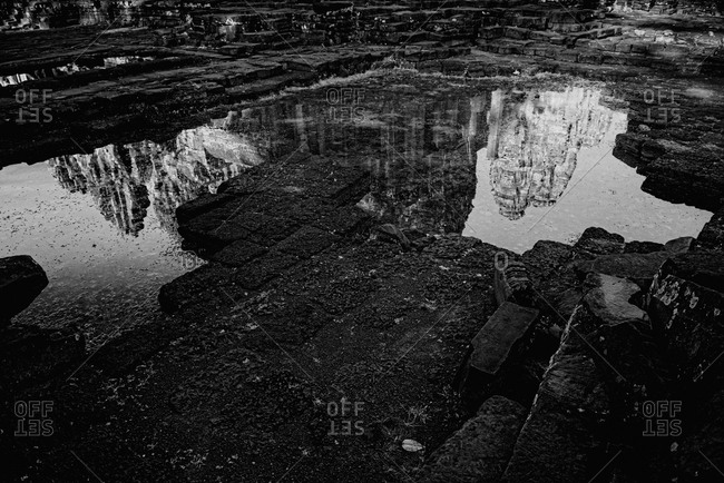 Reflections on water of Prasat Bayon, Angkor Thom, Cambodia