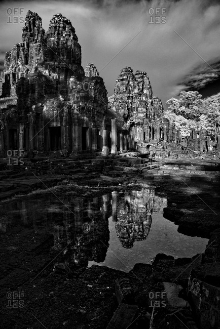 The Bayon temple reflected on water, Angkor Thom, Cambodia