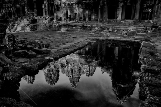 Water reflection of Bayon temple in Angkor Thom, Cambodia
